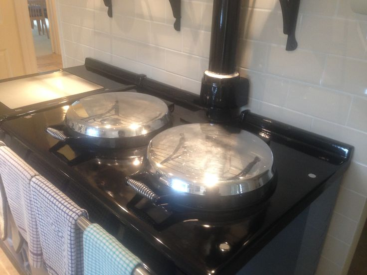 Lovely Clean and Shiny Steel Pan Covers on Baby Blue Aga, cleaned by Mansel