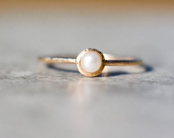 Delicate, artistic, super romantic tiny ring made in 14k yellow gold with natural cultured pearl.  In the back I carved a heart - symbol of your love- which is only visible to person who wears it;)  Excellent as an engagement ring or anniversary gift.  The band is narrow and delicate. It is approximately 1mm wide. I handforged it from 14K gold wire to give it a different look. The head is also matte and not shiny- hammered surface.  Handcrafted with passion by Me.  Makes a wonderful gift or…