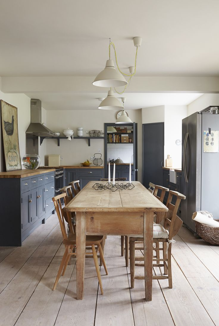 Caroline Yates' lovely kitchen - I like the mixing of wooden knobs and silver handles, suggest to Mum? This is roughly the scale of our kitchen, and the pendant lights don't dangle too much.