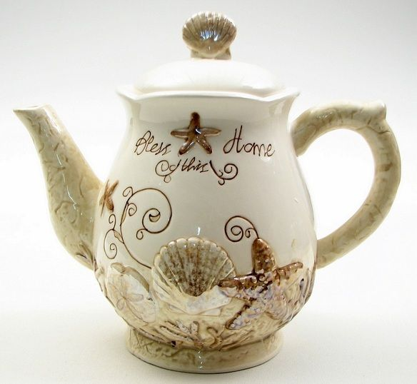 Tea lovers gift: A teapot with coastal design that says Bless this Home. $33.25