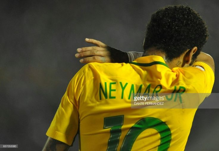 Brazil's Neymar celebrates his goal during their 2018 FIFA World Cup qualifier football match against Uruguay at the Centenario stadium in Montevideo, on March 23, 2017. /