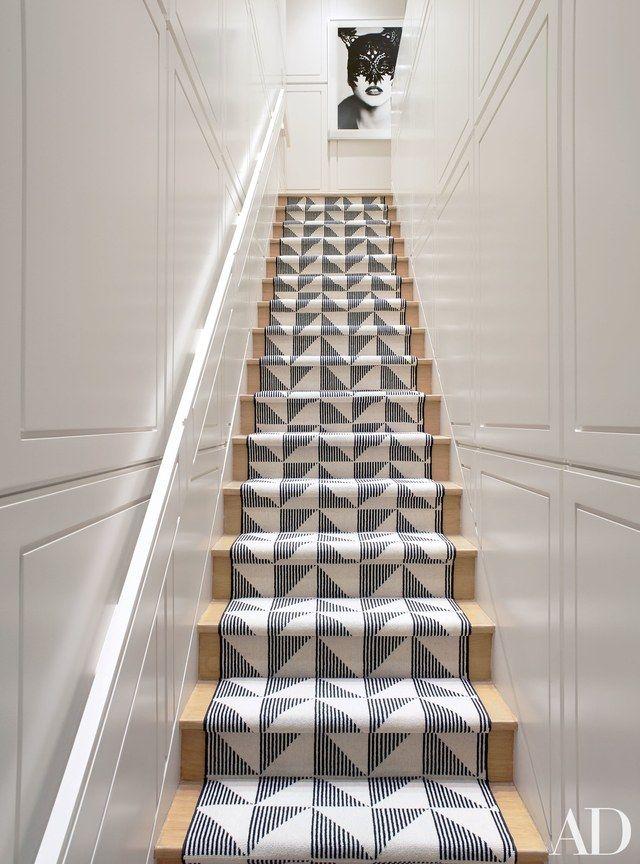 An Ellen von Unwerth photograph surveys the staircase | archdigest.com