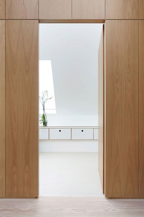 Another example of what looks like a clean wall when closed but secret door to a bathroom. It crossed mind when considering no void. Kew House by Piercy & Company