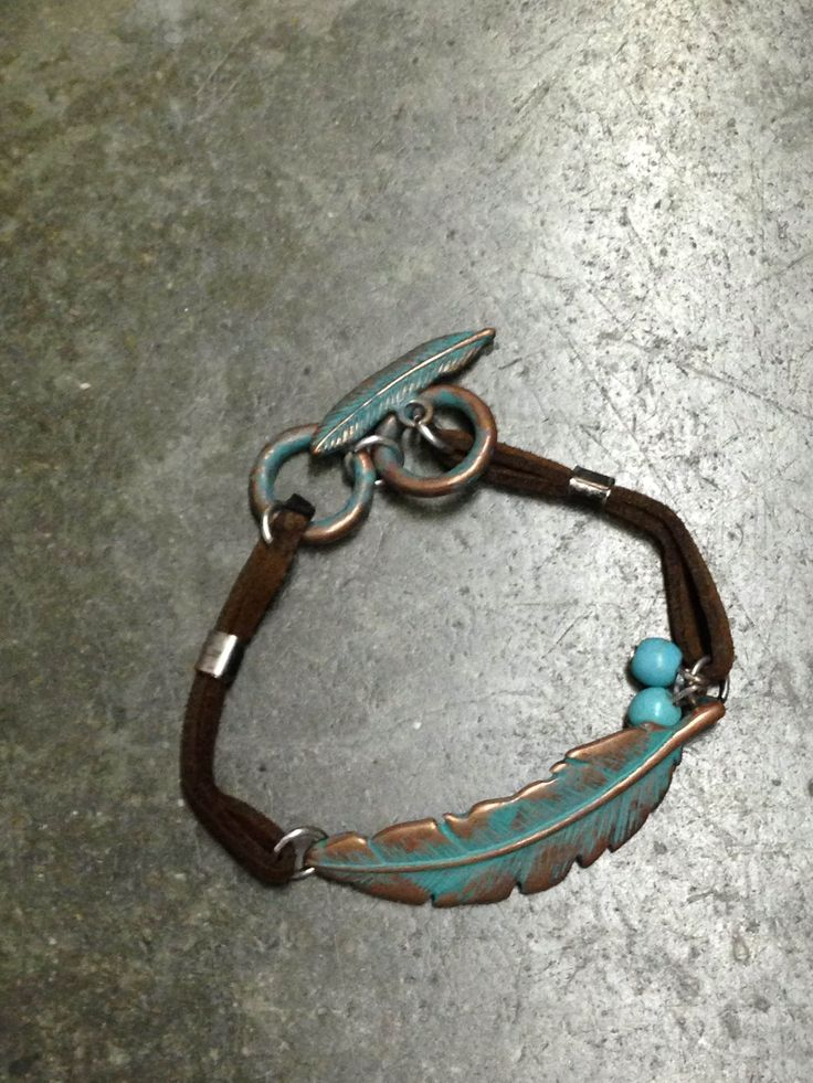 Bronze antique leaf bracelet with turquoise charms and leaf circle closure.