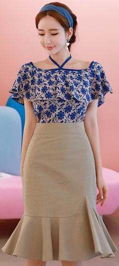 This blue top is so pretty! I like the skirt they've paired it with, too. This would be great for work or date night.