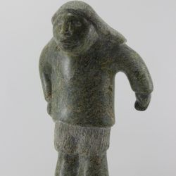 Man carved from beautiful stone by Inuit artist Ineak Padluq, an artist from Lake Harbour