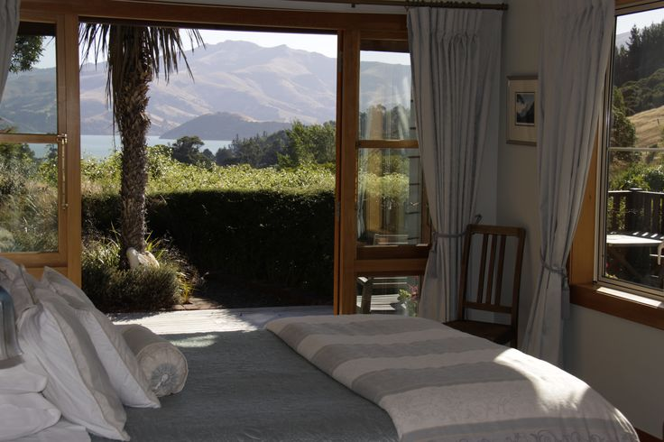 Bedroom at Matua Garden Retreat. Private deck with sea views of Akaroa Harbour.