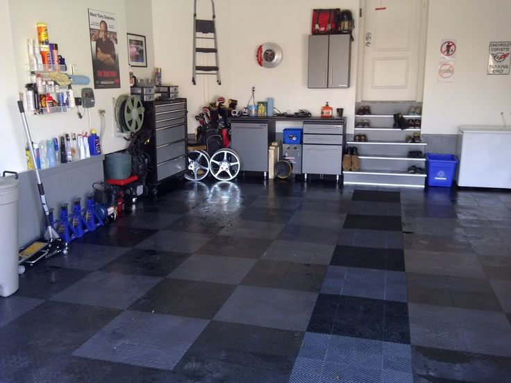 Simple Dark Checkered Garage Floor Combined With Automotive Tools On The  White Wall And Storage: Photo