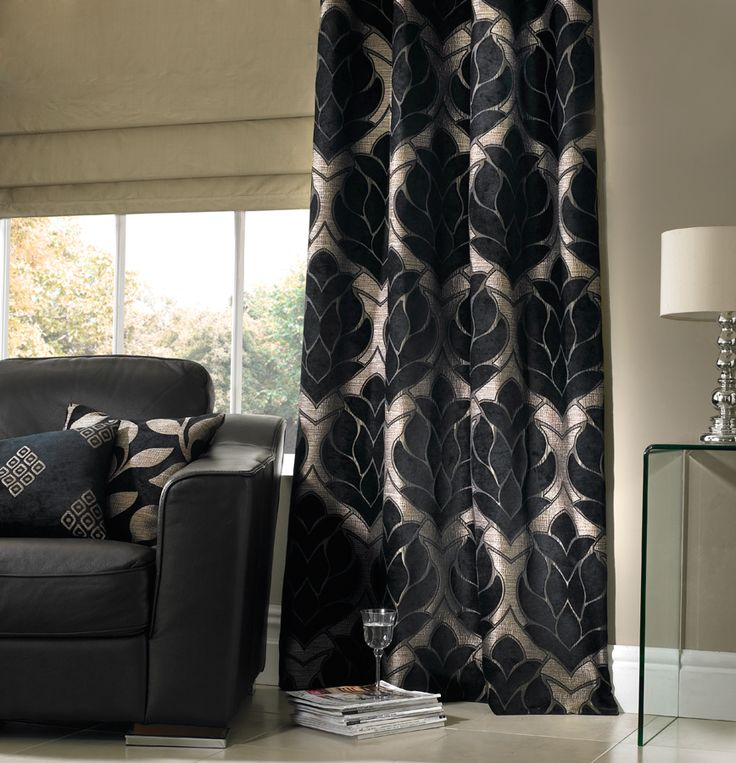 Nothing says luxury quite like a pair of sumptuous curtains at a window. Available in a number of style options, from pinch pleat to pencil pleat, with various additional finishes such as pelmets and tie backs, our range of made to measure curtains offer the ideal bespoke solution to any window. Here in black and cream