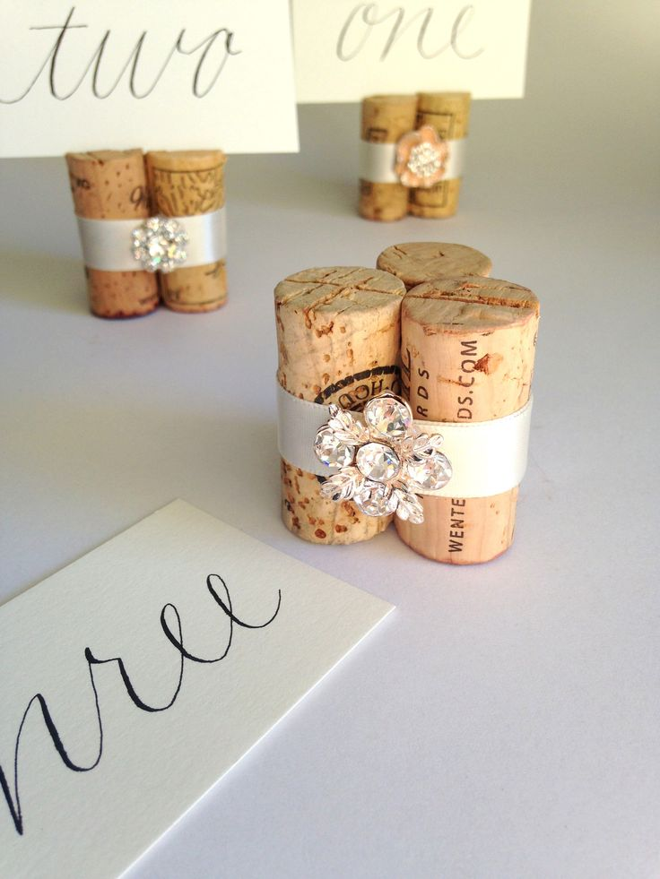 Glam Vineyard Wedding must-have! Gorgeous, sparkly flower-shaped gem set in rose-colored gold on vintage wine corks. High-quality, artisan Place Card Holder or wedding favor! http://karas-vineyard-wedding-2.myshopify.com/products/golden-flower-gemstone-wedding-place-card-holder