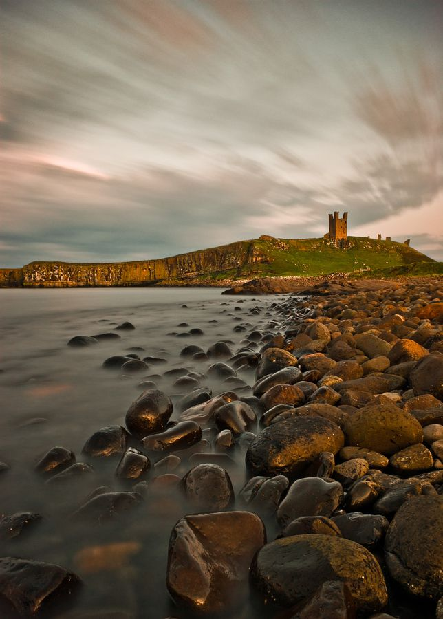 Northumberland Coast (England). 'For a complete contrast to Britain's busy tourist destinations head for the peace and quiet of Northumberland. It wasn't always so tranquil, though, as the legacy of castles in the area shows. Places like Dunstanburgh, Bamburgh and Alnwick were built to control the borderlands with Scotland.' http://www.lonelyplanet.com/england/northeast-england/northumberland