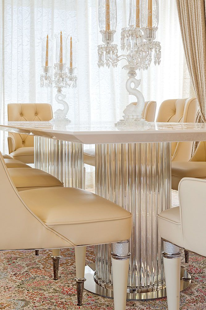 Upholstered dining chairs in sumptuous butter-soft Italian leather.