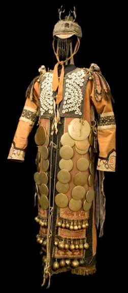 This Shaman's costume (pictures above) is one of a series of elements which allowed a shaman's body to transform into a 'vessel' that received different spirits. Among the Imin Numinchen, shamans were primarily concerned with healing, prediction and with people's relations with their ancestors. This costume belonged to a young female shaman who died in the 1930s, aged 25