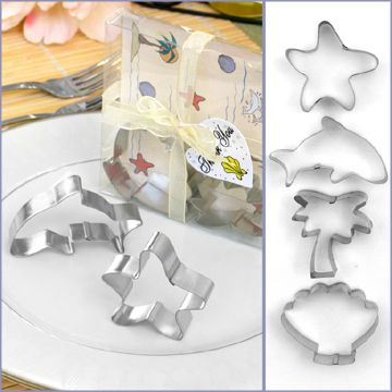 """Ocean Beach & Seashell Cookie Cutter Wedding Favors _ If you're planning a seaside ceremony, why not thank your guests with a """"sweet"""" tropical treat? Our Ocean Beach Cookie Cutter Wedding Favors add a taste of the good life to your favorite cookie recipe, recalling memories of your destination wedding with cute, beach theme shapes.  Each box of cookie cutters holds a Starfish, a Seashell, a dolphin, & a palm tree. Cookie cutters 2.5"""" x 2""""."""