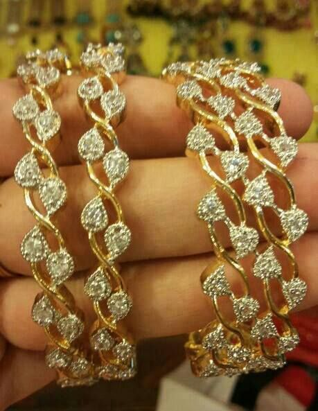 diamonds set in gold bangles