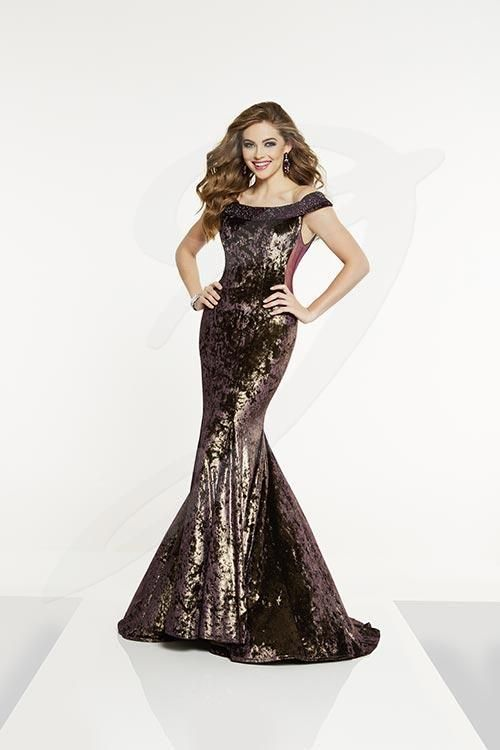 Balletts Bridal - 25388 - Prom by Jacquelin Bridals Canada - Plush crushed velvet is the fabric for this stunning sheath. The off the shoulder collar has rhinestones. The matching sheer side bodice panels add flare, and the trumpet skirt with a sweep train follows you on the red carpet.