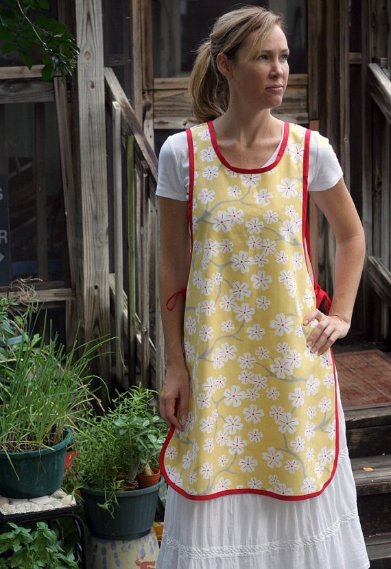 Love this style of pinafore apron but NO RED. It looks very comfy.