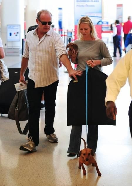 At the airport, Kelsey Grammer, wife and doxies. There is an episode on The Dog Whisperer featuring their doxies. Really cute.