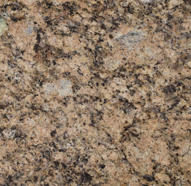 Giallo Veneziano Granite. Giallo Veneziano is a peachy gold granite from Brazil. It has dark brown and grey vein-like markings throughout.