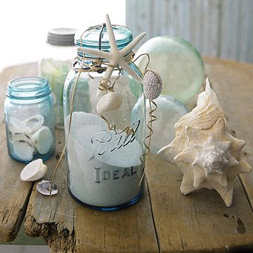 Seashell Sand Jars:    Shells work wonders for plain jars. Fill jars with sand, then wrap raffia or twine around the jar tops. Tuck in starfish and tie on sand dollars, shells, and other various beach treasures.