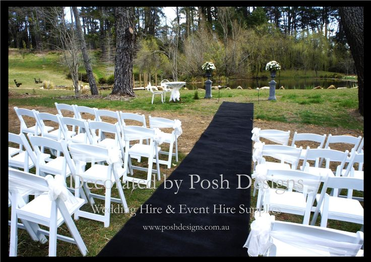 White outdoor gladiator chairs, white organza sashes, black aisle carpet, urns and pedestals with fresh flowers , signing table and chairs all for hire for your outdoor ceremony. Australia wide. Visit www.poshdesigns.com.au for more photos and info, or email lisa@poshdesigns.com.au for pricing packages.