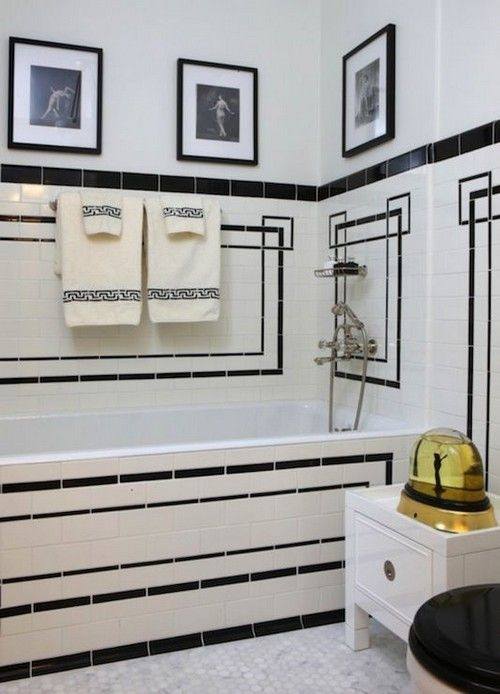 Art deco bathroom with drop-in tub and vintage white subway tile surround with black