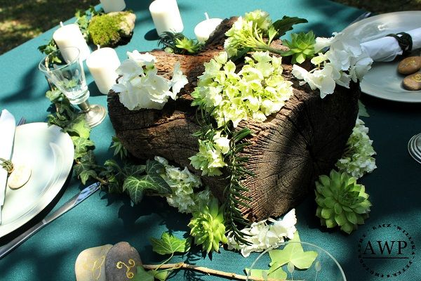 wooden centerpiece with green-white  hydrangea and succulents