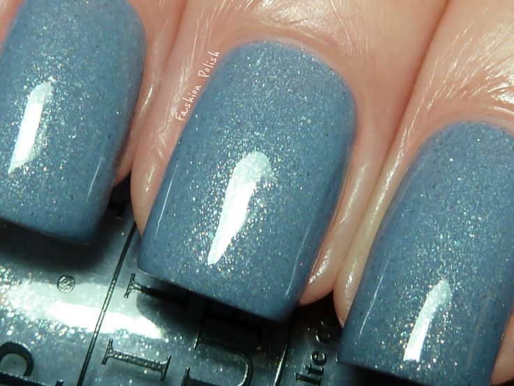 "OPI 'I Don't Give a Rotterdam' glittery light blue nail polish.    "":O)"