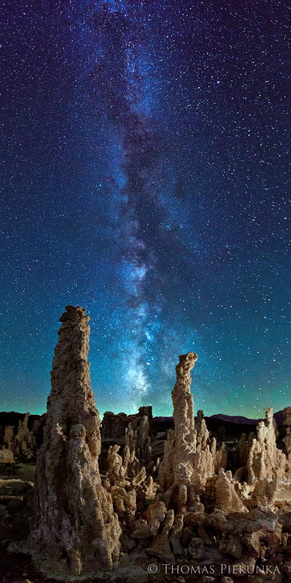"""The moon had just set directly where the Milky Way became visible giving the sky a turquoise glow that I have not seen since. These are the tufa towers at Mono Lake on the eastern side of the Sierra Nevada mountains outside of Yosemite National Park. The combination of the Milky Way and these ancient formations gives the image a timeless quality. This is a 2 shot vertical panorama. I wanted the image to be like a slice of time and space, thus, the title."""