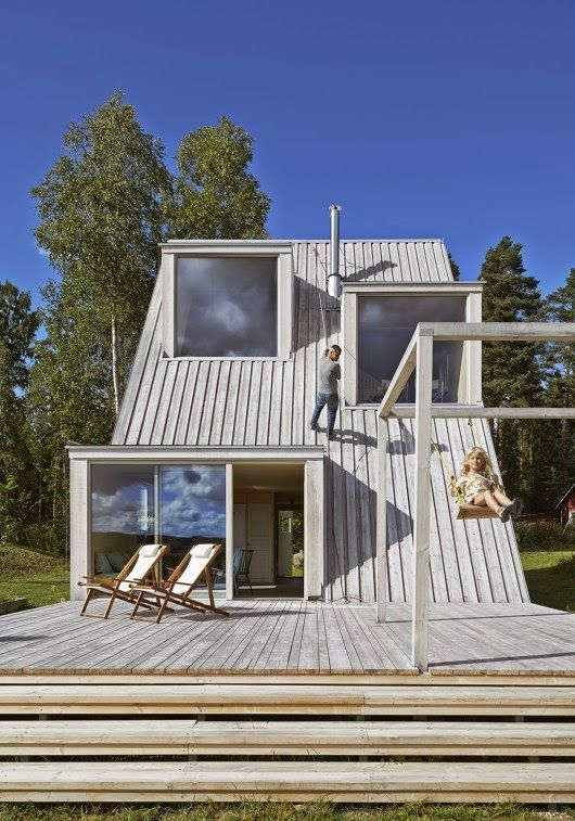 Architect Leo Qvarsebo designed the summer retreat for himself and his children. Positioned between a patch of woodland and a green pasture in Dalarna, the Qvarsebo Summerhouse was designed to make the most of its picturesque setting.