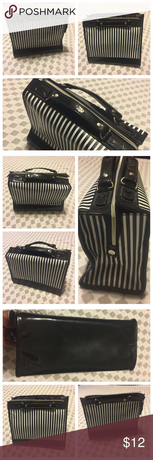 Lancôme Signature Travel Cosmetic Bag Lancôme Signature Travel Cosmetic Bag. Black and White color. Has 2 inside wall elastic pockets. See photos attached for measurements. Preowned but Very clean inside and out. No hold, no trade, and no modeling. Lancome Bags Cosmetic Bags & Cases
