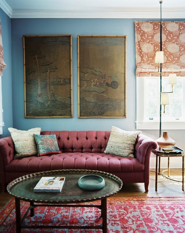 upholstered chesterfield. tribal rug. chrysanthemum shade. Rice paper painting. Babmoo table Celadon bowl. What's not to love?