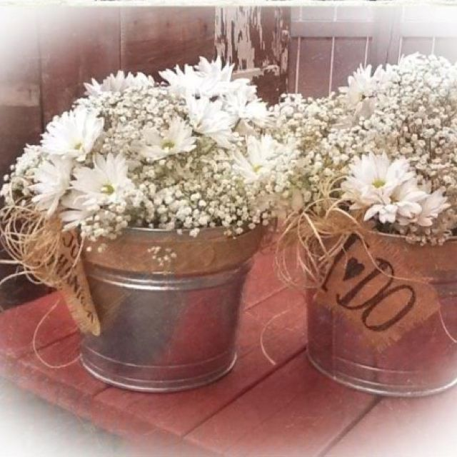 Baby's breath with white flowers in galvanized buckets