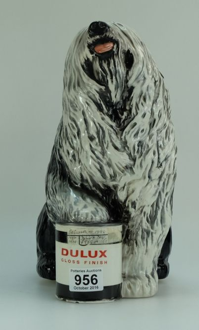 Collectors & General Auction – Lot 956 – Beswick figure of a Old English Sheepdog with foot on Dulux paint tin 1990 height 32cm.  Sale Price £220.00.