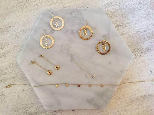 Murkani Hoop Earrings, Hanging Chain Disc Earrings and Choker Necklace all from Grace Collection