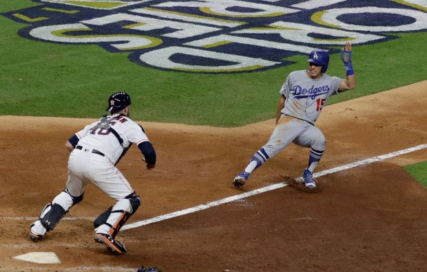 Los Angeles Dodgers' Austin Barnes is caught in a rundown with Houston Astros catcher Brian McCann during the sixth inning of Game 4 of baseball's World Series Saturday, Oct. 28, 2017, in Houston. (AP Photo/David J. Phillip)