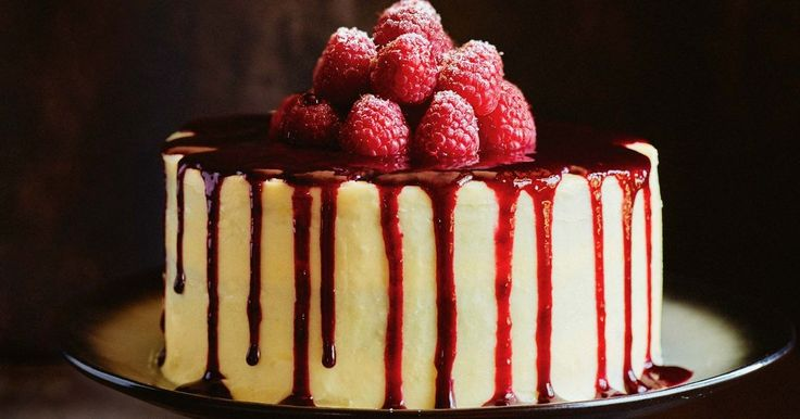 Topped with a rich raspberry puree and fresh berries, this white-choc and coconut cake is a slice of heaven.