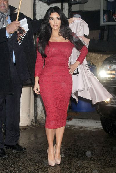 Kim Kardashian braved the rain in a red lacy cocktail dress for co-hosting Live With Kelly.
