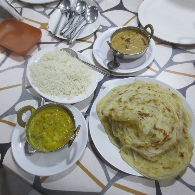 Our favourite dinner, Paneer butter masala, Aloo muttor, rice and Porotta, Allepey, Kerala, India. Cost 334INR = $7AUD.