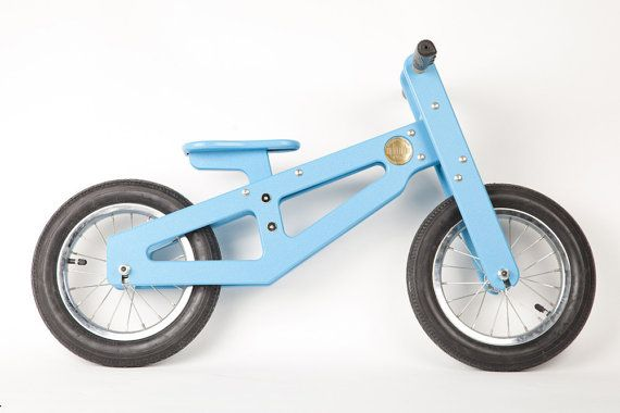 Heritages recycled milk jug balance bike takes away gears and chains, bringing riding back to basics: balance. With a low bike seat and