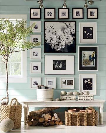 Black and white gallery wall agains duck egg blue