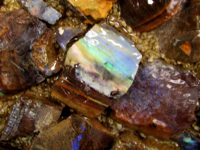 bonanza find opal panel with water fall over it