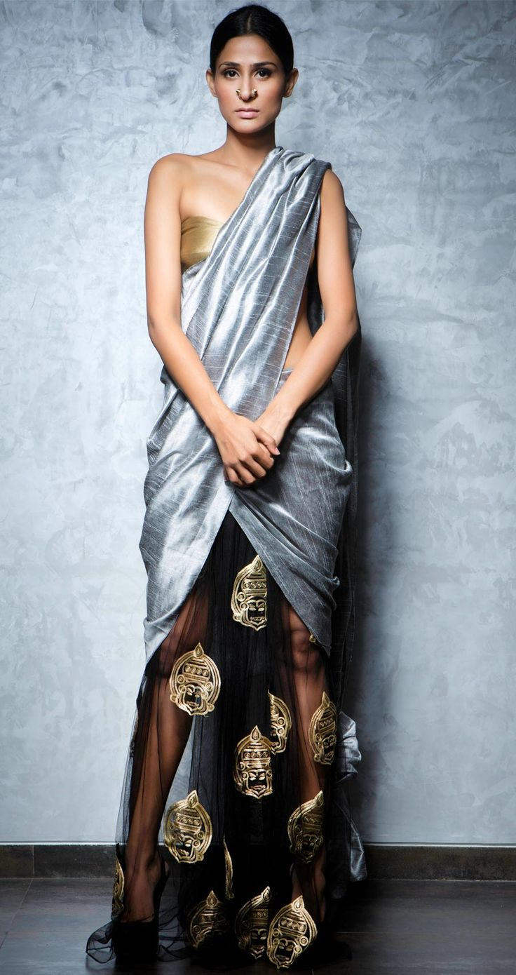 Metallic tulip hemlined silk sari with kathakali motifs on the net and a gold silk bustier by NIKHIL THAMPI http://www.perniaspopupshop.com/lakme-fashion-week/nikhil-thampi/nikhil-thampi-tulip-hem-saree-nktlfw081310.html