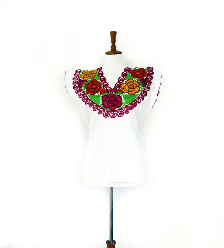 Pretty Mexican top. Hand-embroidered with beautiful pink flowers. Made with Muslin-soft and comfortable. $29 USD