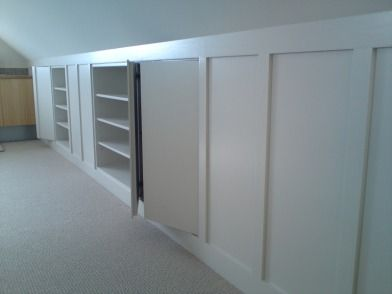 Under eaves storage; no shelves just open space.  I like the panelling