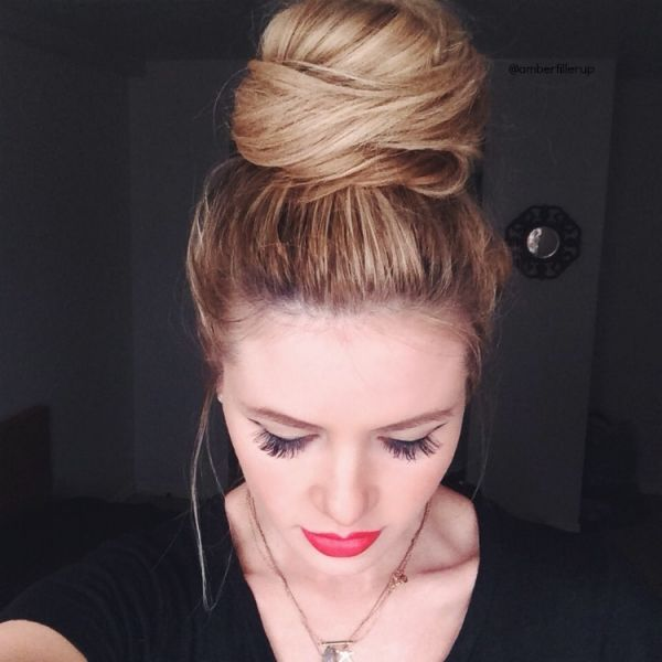 Put hair in ponytail on top of head. Then, section off the ponytail. Tease each section. As you teach, wrap it around until it creates a bun that looks a little bit like cotton candy.