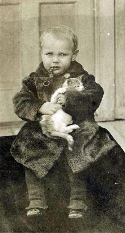 It's amazing how many old portraits we've found of children with kittens and pipes…