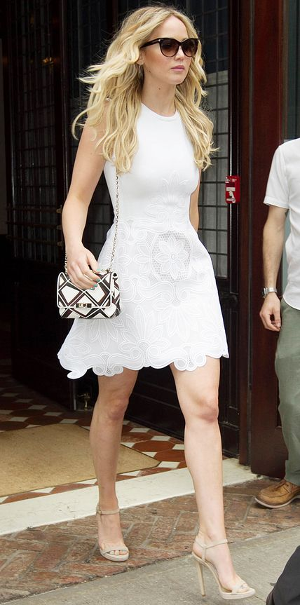 Jennifer Lawrence stepped out in a sweet fit-and-flare cotton-and-lace macramé Antonio Berardi LWD that she styled with a graphic black-and-white Roger Vivier chain purse and nude sandals.