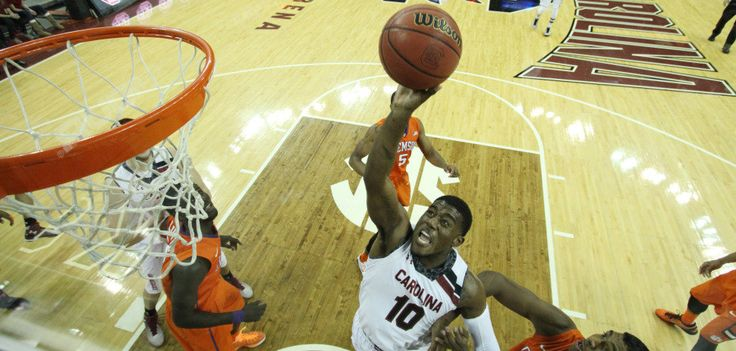 South Carolina Tames Clemson Tigers With Stout Second Half - http://www.beachcarolina.com/2014/12/20/south-carolina-tames-clemson-tigers-with-stout-second-half/ COLUMBIA, SC Dec. 19, 2014 –Emboldened by a raucous crowd of over 11,000 fans, the South Carolina Gamecocks (6-3) earned a big win over archrival Clemson (6-4) Friday evening at Colonial Life Arena.Duane Notice would score 14 of his game-high 19 points over the final 20 minutes, helping C... Beach Carolina