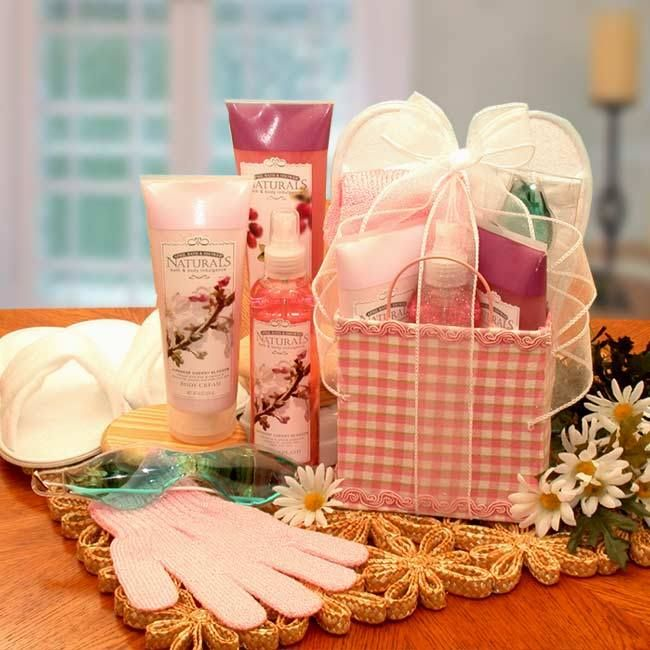 BATH DELIGHTS TOTE  http://basketsformymom.com/  Send her an indulgent spa experience to use right at home with our Bath Delights On The Go Tote. A sweet blend of floral aromas and soft terry cloth slippers will whisk her away.